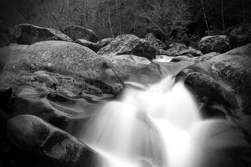 Blurred Motion and Slow Shutter Waterscape Black and White Photography of a River Waterfall in the Great Smoky Mountains. royalty free stock photo
