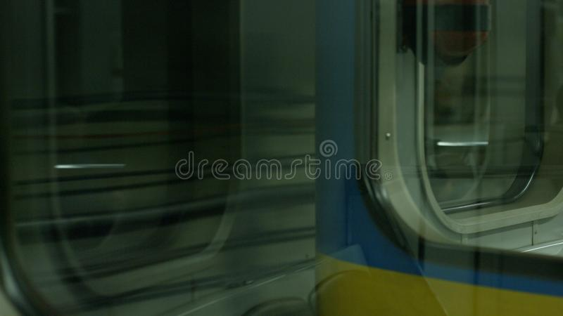 Blurred motion of the train in underground. Subway car in motion, inside view royalty free stock photo
