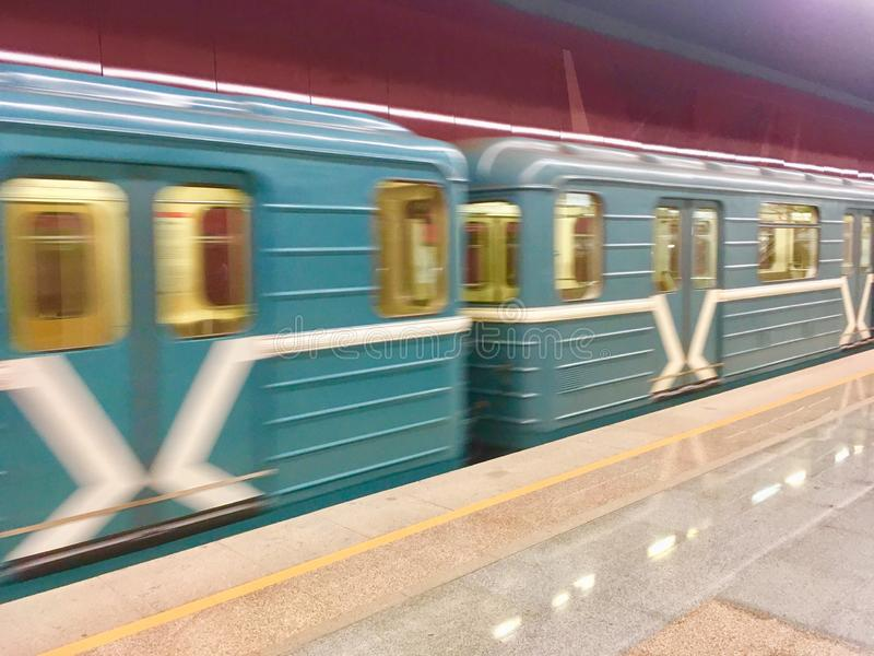 Blurred moving Moscow Metro Train. The most common Moscow Metro train design operating in 90th, 2000nds and 2010th in Moscow, Russia stock image