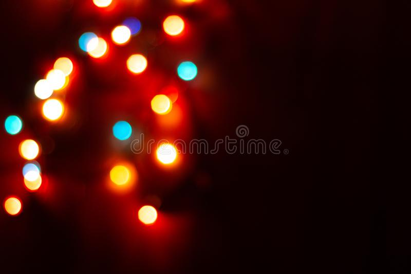 Blurred multicolor lights, dark background with space for text. Blurred multicolour lights, dark background with space for text. Abstracted Christmas and New stock photography