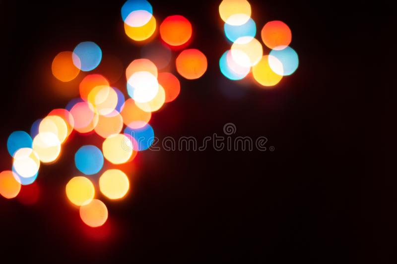 Blurred multicolor lights, dark background with space for text. Blurred multicolour lights, dark background with space for text. Abstracted Christmas and New royalty free stock image