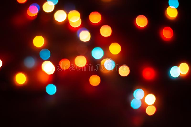 Blurred multicolor lights, dark background with space for text. Blurred multicolour lights, dark background with space for text. Abstracted Christmas and New stock photo