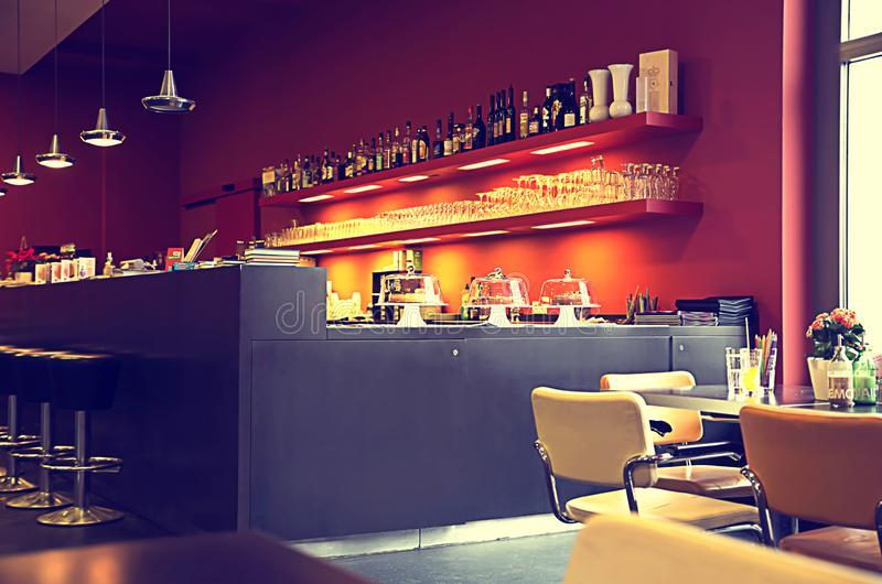 Blurred multicolored interi or background cafe in a modern style of purple and cherry tones, as a screensaver, Wallpaper. Blurred multicolored interior stock photos