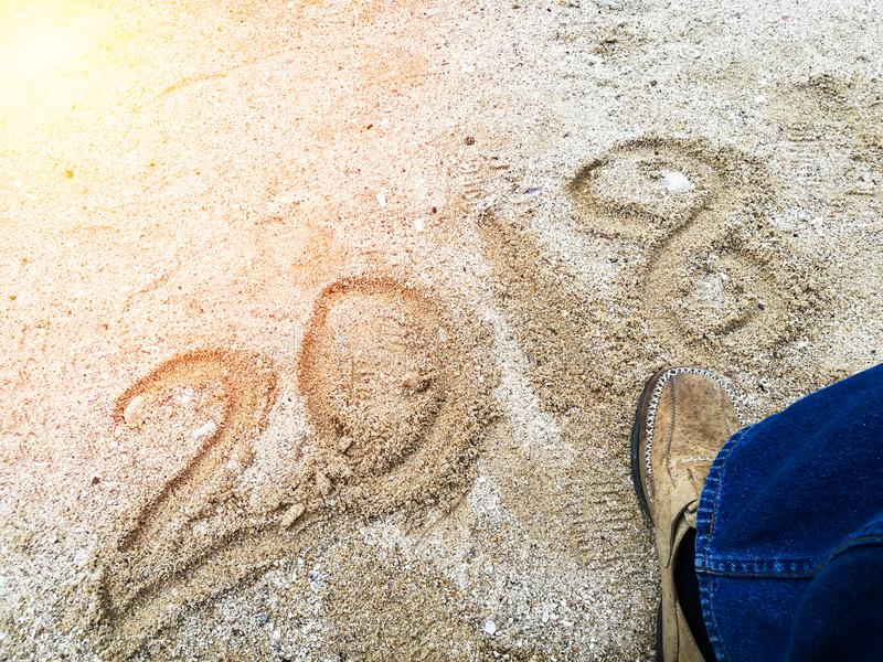 Blurred new year 2018 is coming concept. Happy New Year 2018 Ste. P across 2017 concept on the sea beach stock photography