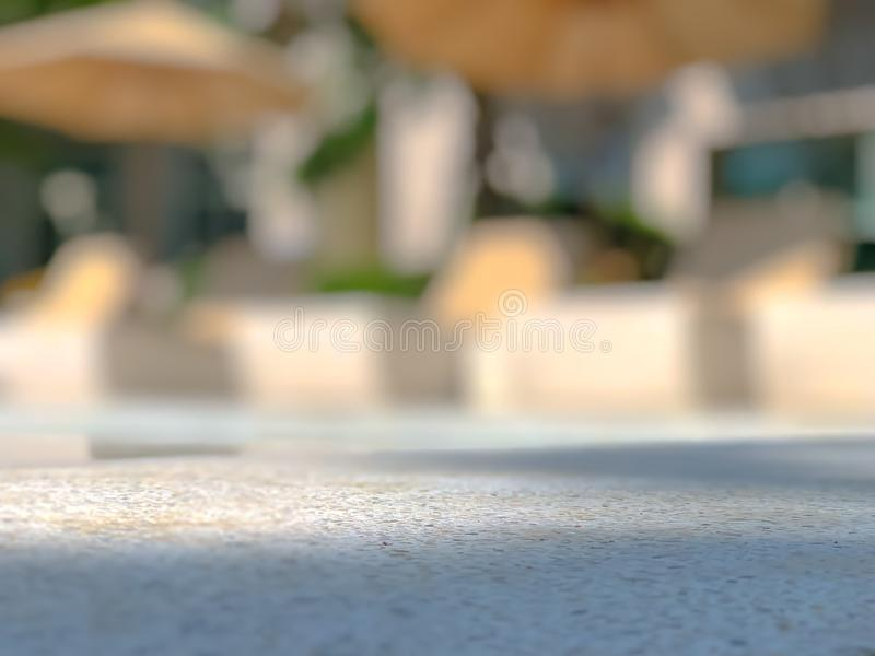 Blurred of resort style chair with umbrella and swimming pool. Blurred outdoor of resort style chair with umbrella and swimming pool stock photography