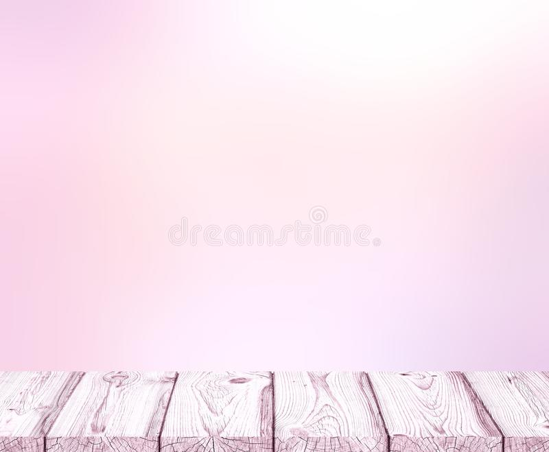 Blurred pale pink background and light pink empty wooden table. Glamorous blank background. stock images
