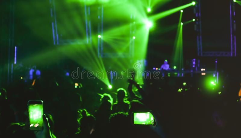 Blurred people dancing at music night festival event party. Blurred people dancing at music night festival event - Abtsract defocused image background of disco royalty free stock images