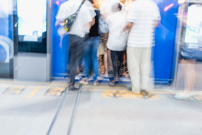 Blurred people getting in railroad station urban systems in most cities. For background royalty free stock images