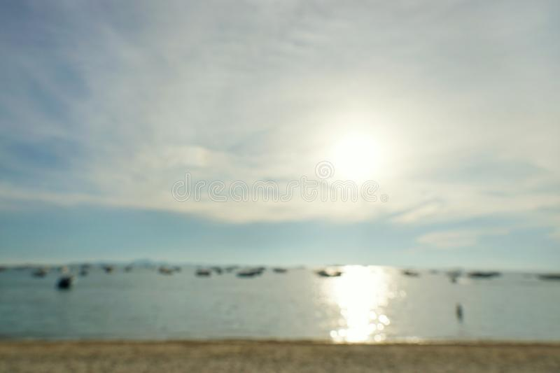 Blurred people having sunset beach and Speed boats in summer vacation at Pattaya beach. Blurred people having sunset beach and Speed boats in summer vacation at royalty free stock photo