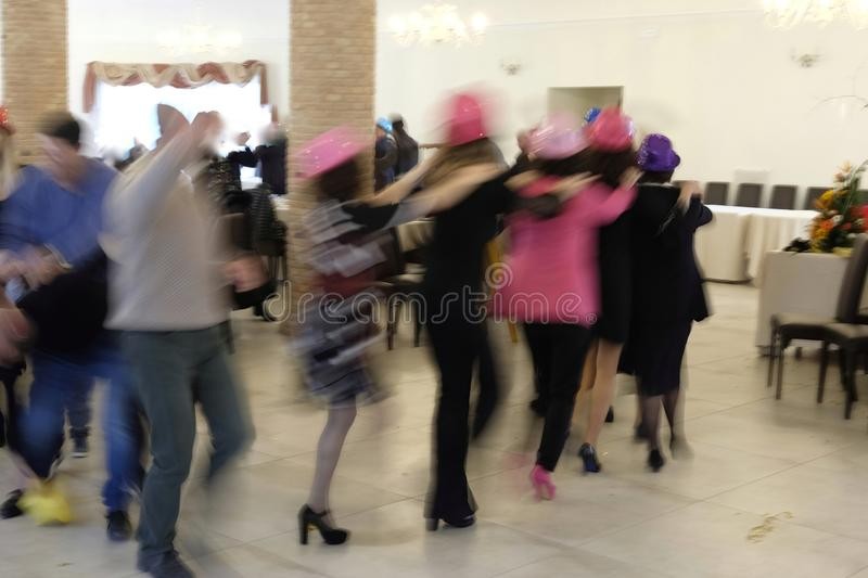 Blurred people make a train at the party royalty free stock photos