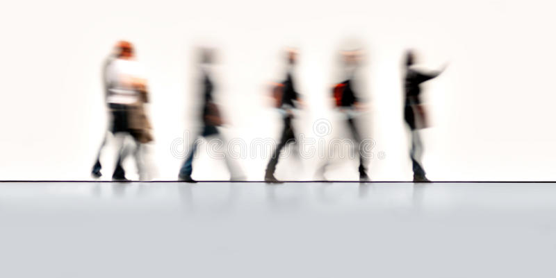 Blurred people in motion stock image