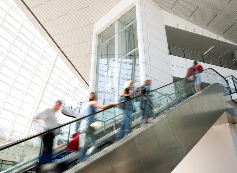 Download Blurred People Moving Up The Escalator Stock Image - Image of passengers, staircase: 26542399