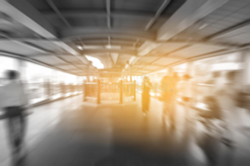 Blurred people walking on skywalk under electric train station in Bangkok City, stock images