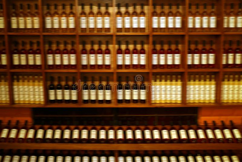 Blurred Peruvian Pisco Brandy Bottles on the Shelf, Ica region, Peru, South America. Texture background, alcohol, alcoholic, antique, bar, beverage, brown royalty free stock images