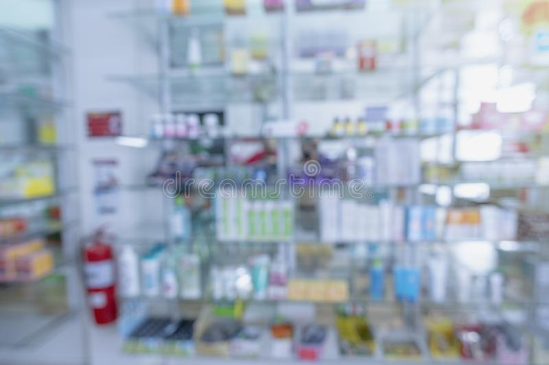 Blurred Pharmacy drugstore. Pharmacy drugstore retail Interior blur background with healthcare product on medicine cabinet.Pharmacy interior with blurred royalty free stock image