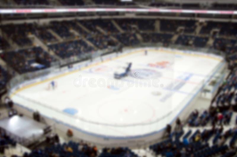 Blurred photo of the crowded hockey arena. Blurred photo of the hockey arena. Indoor game. People at the stadium stock image