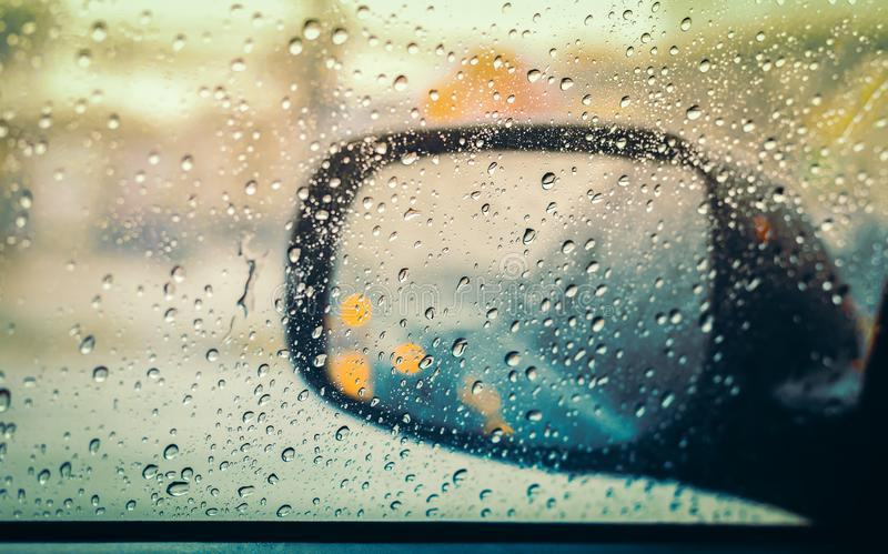 Blurred rain drop on car glass background, water drops at the car window driver side royalty free stock image