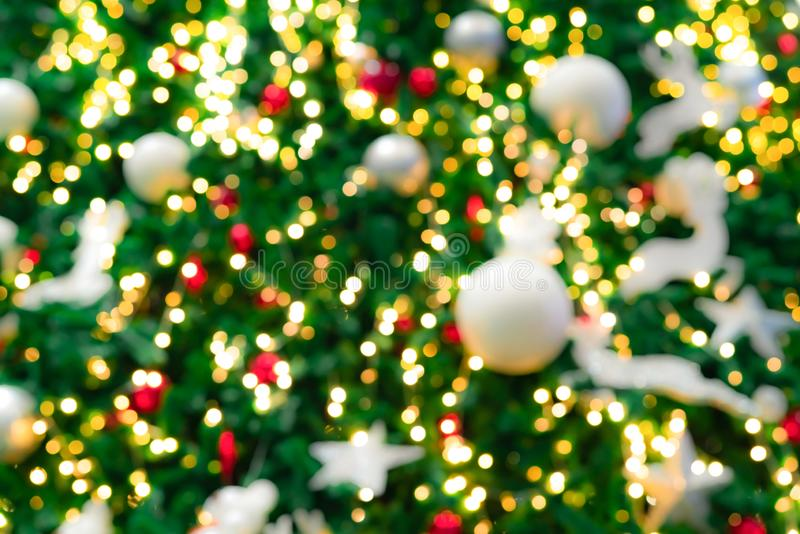 Blurred red, green, and gold bokeh background of Christmas tree. Xmas background. Christmas and Happy New Year holiday background. royalty free stock photos