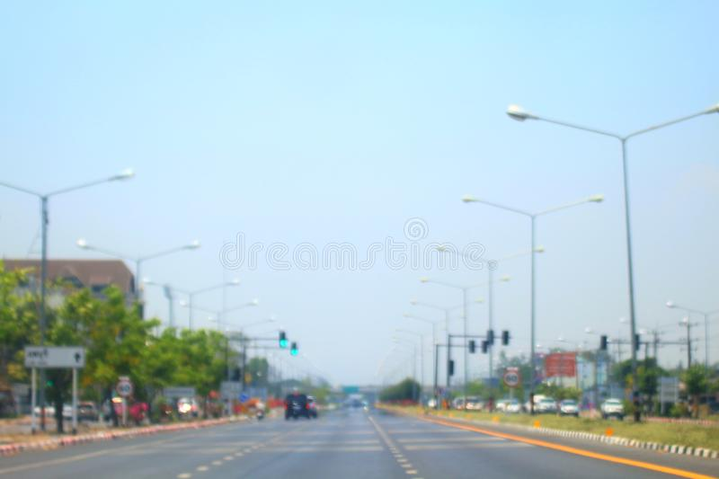 Blurred road and car background abstract of Long road way in city with car royalty free stock photos