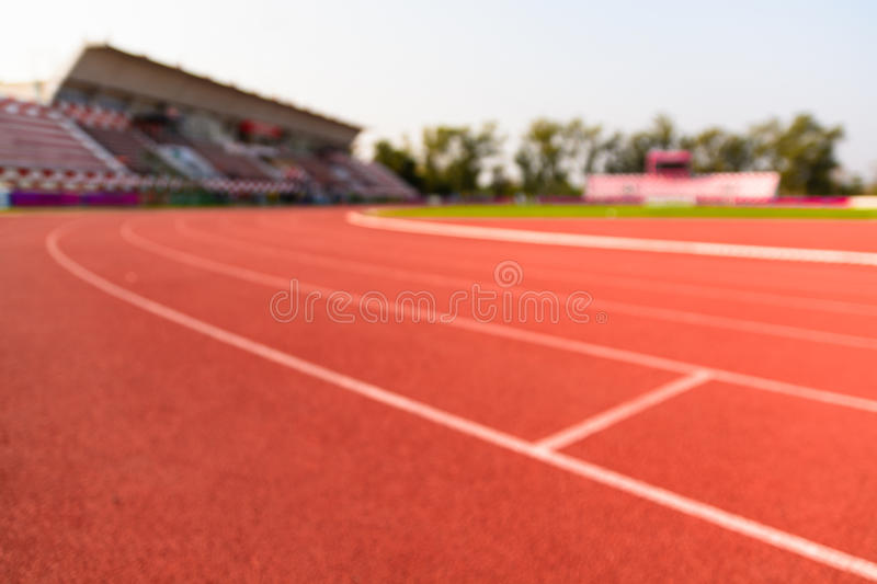 Blurred Running tracks and Grandstand royalty free stock image