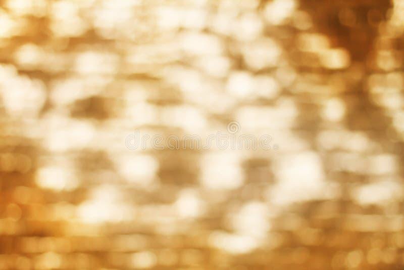 Blurred sea surface blink bokeh. Warm tone royalty free stock image