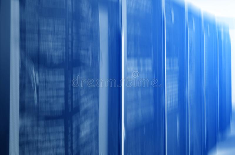 Blurred server rack. Blue light. Futuristic data center. Blurred server rack. Blue light.Futuristic data center stock images
