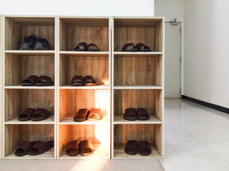 Blurred of the shelf for shoes in the white room. With light from outside. stock image