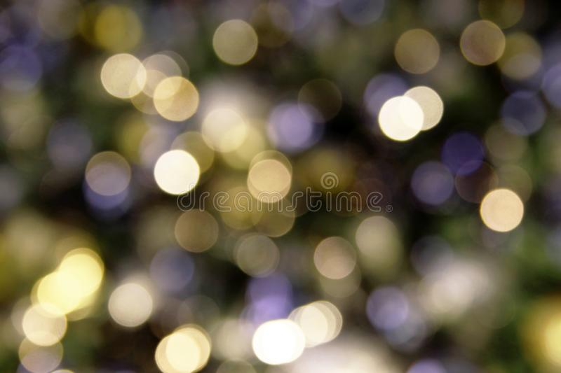 Blurred shiny background white, yellow and blue colors for New Year and Christmas theme. Blurred shiny background white, yellow and blue colors for New Year and royalty free stock images