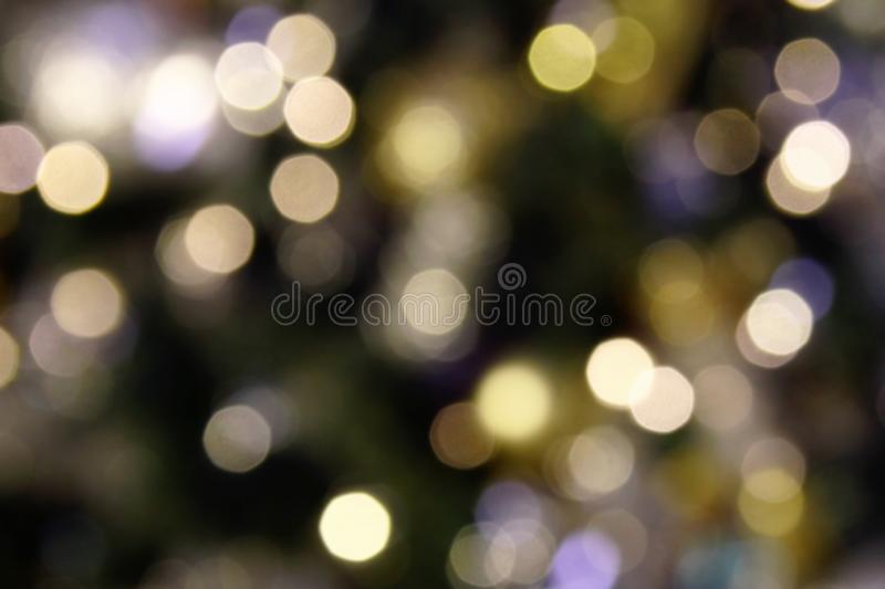 Blurred shiny background white, yellow and blue colors for New Year and Christmas theme. Blurred shiny background white, yellow and blue colors for New Year and stock photos