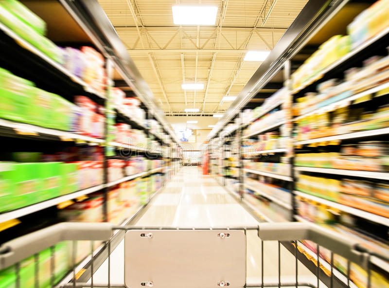 Blurred shot of an isle in a supermarket or grocery store shop stock photo
