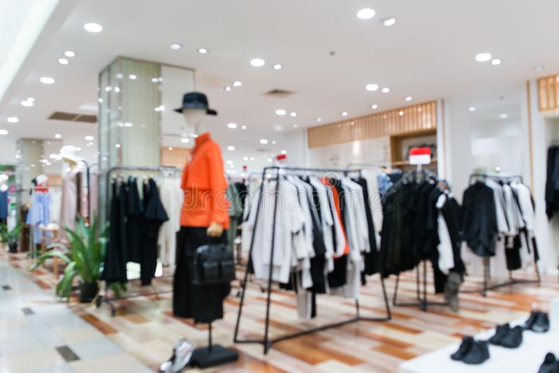 Blurred showcases fashion boutique Clothing store in a modern shopping mall. Cloth and acessorie modern shop blur stock photo