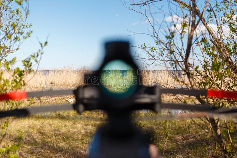Blurred sight crossbow aiming from the first person royalty free stock images