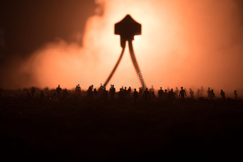 Blurred silhouette of giant monster prepare attack crowd during night. Selective focus. Decoration. Blurred silhouette of giant monster prepare attack crowd stock photography