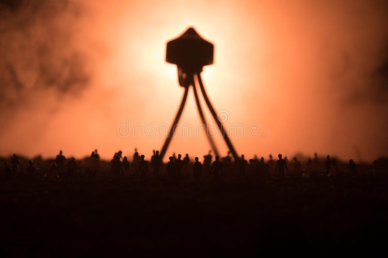 Blurred silhouette of giant monster prepare attack crowd during night. Selective focus. Decoration. Blurred silhouette of giant monster prepare attack crowd royalty free stock photo