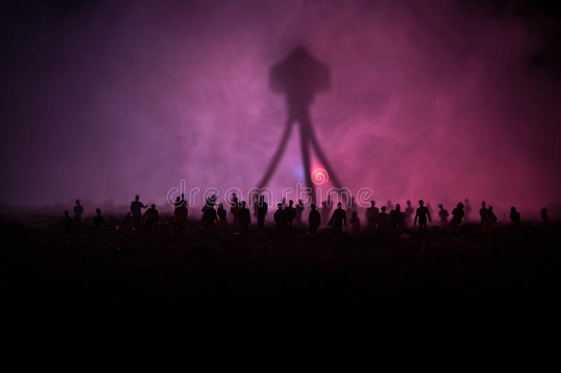 Blurred silhouette of giant monster prepare attack crowd during night. Selective focus. Decoration. Blurred silhouette of giant monster prepare attack crowd stock image