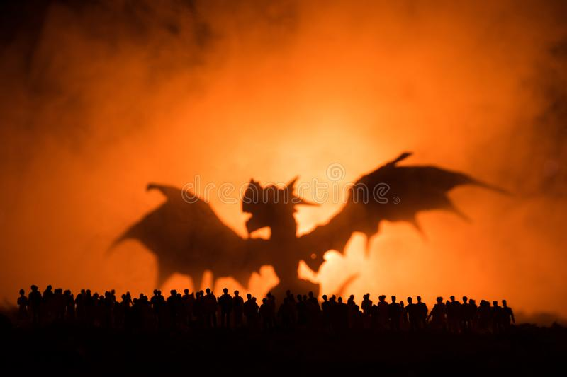 Blurred silhouette of giant monster prepare attack crowd during night. Selective focus. Decoration. Blurred silhouette of giant monster prepare attack crowd royalty free stock images