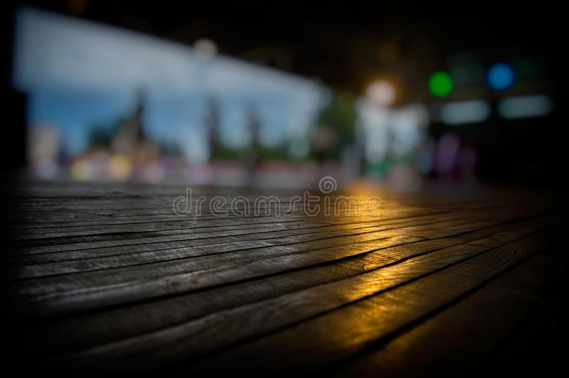 Blurred silhouettes of people and dance floor royalty free stock photo