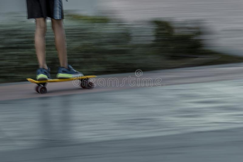 Blurred skater riding on street stock image