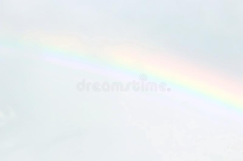 Blurred sky and rainbow soft, blurred soft rainbow on sky pastel color background, nature rainbow sky wallpaper stock photography