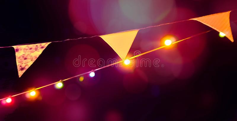 Blurred summer party outdoor bulb garlands. Blurred colorful summer party outdoor bulb garlands royalty free stock images