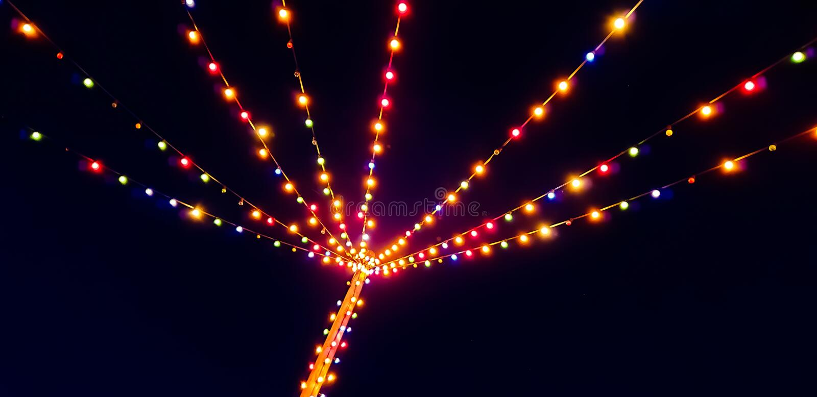 Blurred summer party outdoor bulb garlands. Blurred colorful summer party outdoor bulb garlands royalty free stock photo