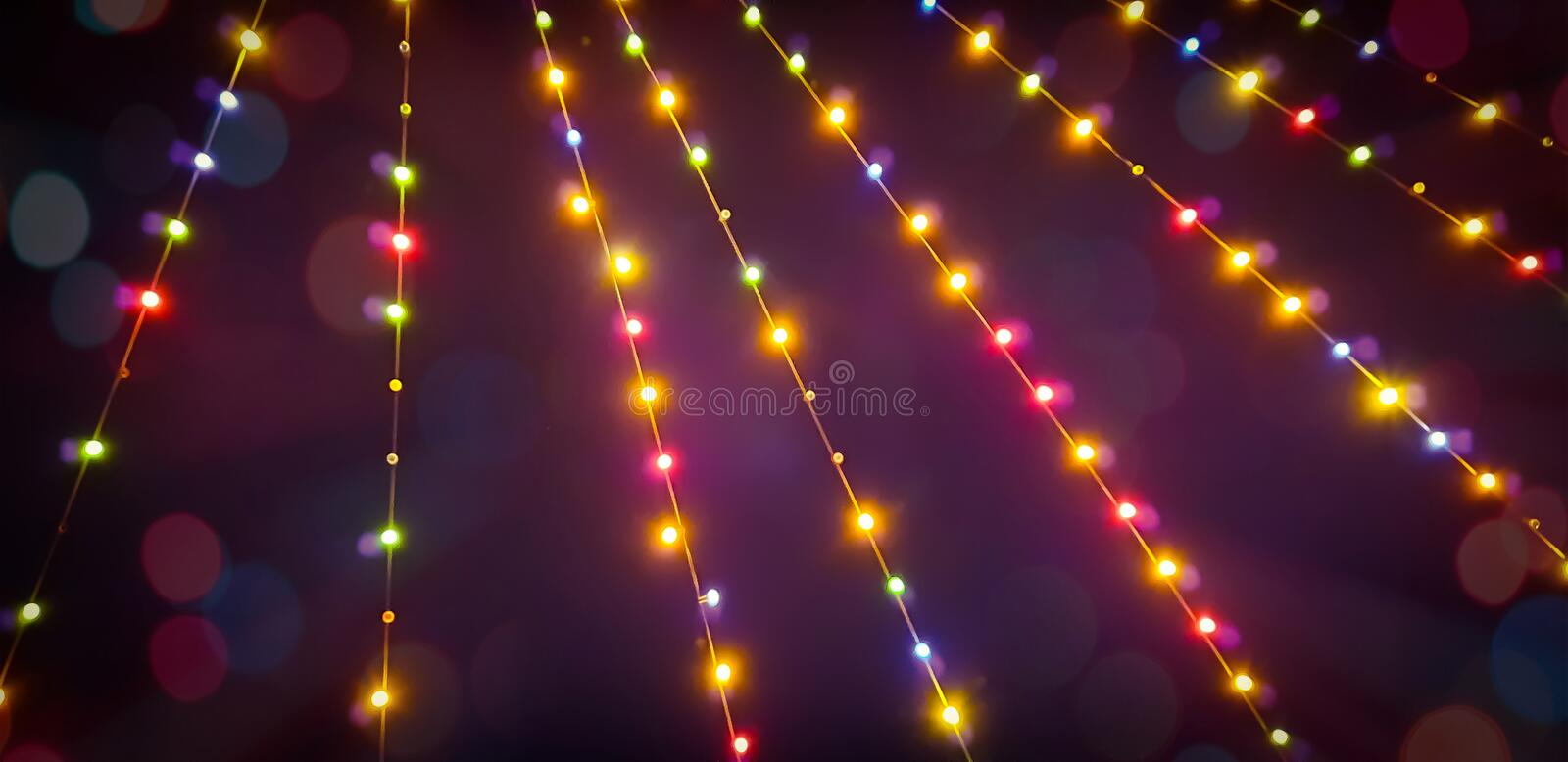 Blurred summer party outdoor bulb garlands. Blurred colorful summer party outdoor bulb garlands stock photography