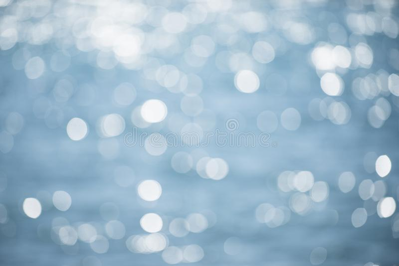 Blurred texture of shining sea surface with waves. Beautiful defocused background, sparkling, shimmering. Sea, ocean. Water texture bokeh. Background concept royalty free stock photography