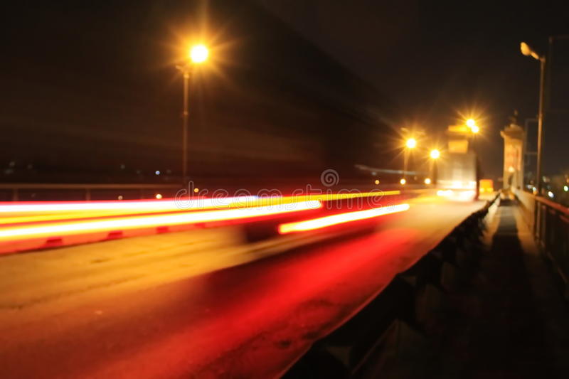 Blurred traffic light trails on road at night. Blurred traffic light trails on the road at night stock image