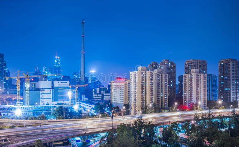 Blurred traffic light trails on road night in China. Blurred traffic light trails on road at night in China stock images