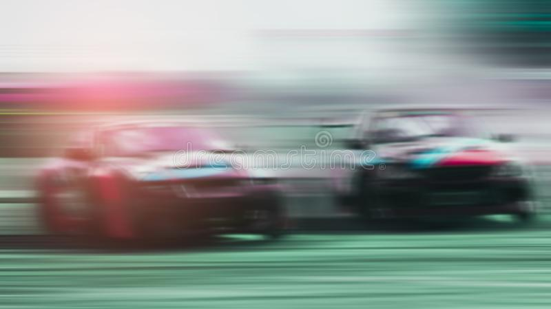 Blurred -two sports cars are competing battle on and running at high speed outdoor race car drift with excitement, Xstream royalty free stock photos