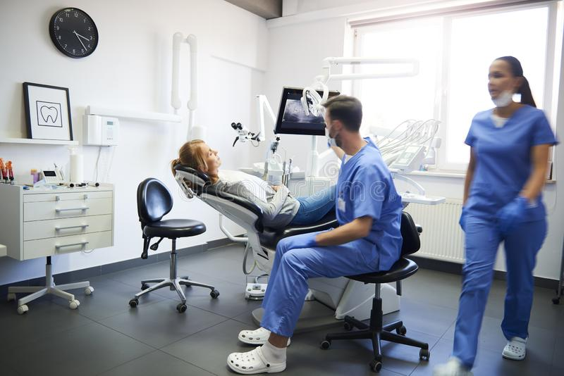 Blurred view of busy dentists at work royalty free stock images