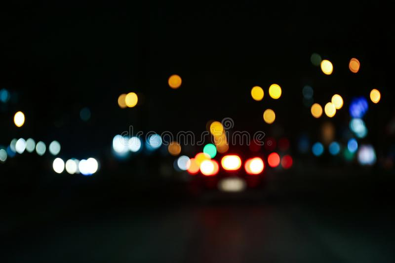 Blurred view of city at night. Bokeh. Effect stock photos
