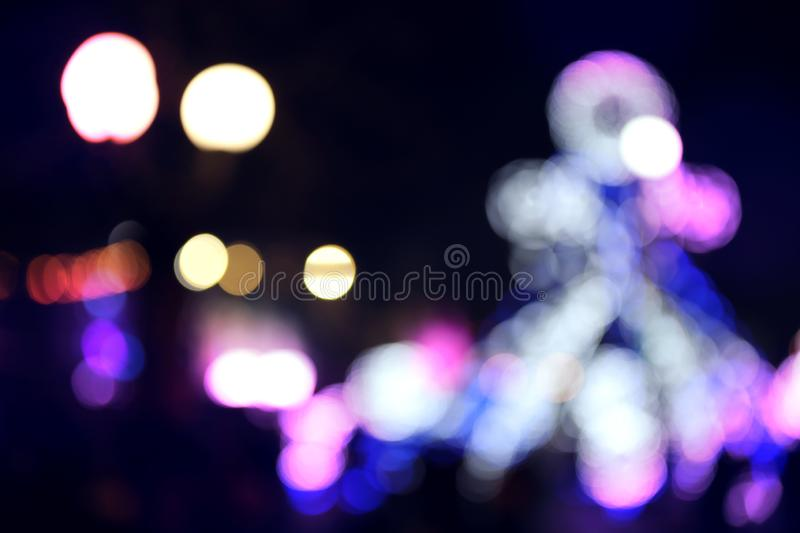 Blurred view of city street with festive lights. Bokeh effect. Blurred view of city street with festive lights at night. Bokeh effect stock image