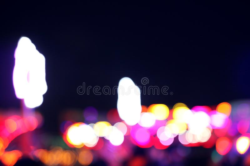 Blurred view of city street with lights at night. Bokeh effect. Blurred view of city street with festive lights at night. Bokeh effect royalty free stock photo